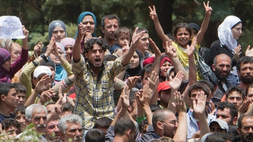 June 15: Syrian refugees protest against President Bashar Assad, in a camp in Yayladagi, Turkey, near the Syrian border.