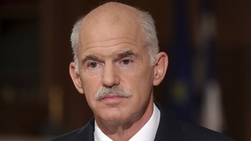 June 15: Greece's Prime Minister George Papandreou is pictured during a televised address at Maximos mansion in Athens.