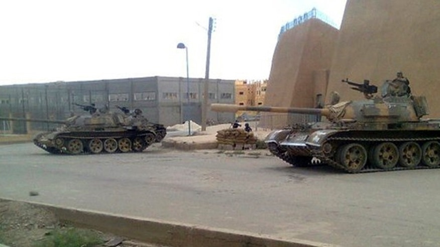 June 14: In this citizen journalism image made on a mobile phone and provided by Shaam News Network, a Syrian army tank is deployed in the Syrian eastern province of Deir el-Zour, Syria.