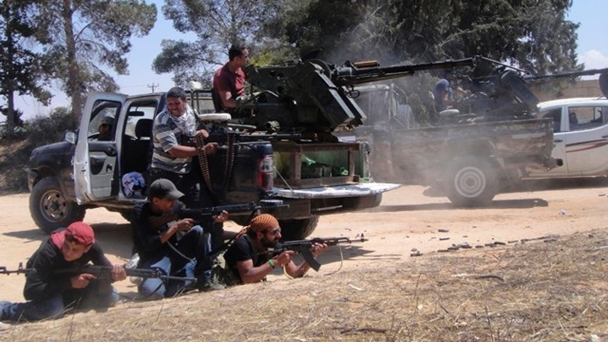 June 17: Rebel fighters fire their machine gun towards pro-Qaddafi forces on the front line of Dafniya in Misrata, Libya.