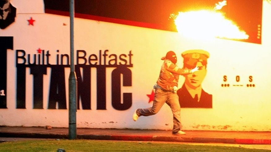 June 21: Loyalist rioters throw petrol bombs towards the mainly Catholic Short Strand area of East Belfast, Northern Ireland.