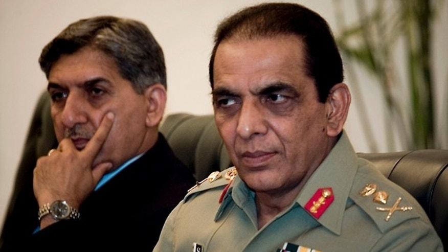 June 11: Pakistan's army chief Gen. Ashfaq Parvez Kayani, right, and Pakistan's intelligence chief Lt. Gen. Ahmed Shuja Pasha attend a meeting of Pakistan-Afghanistan's joint peace commission in Islamabad, Pakistan.