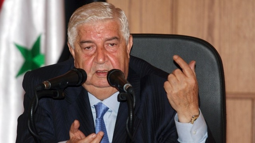 June 22: Syrian Foreign Minister Walid Moallem speaks during a news conference in Damascus, Syria.