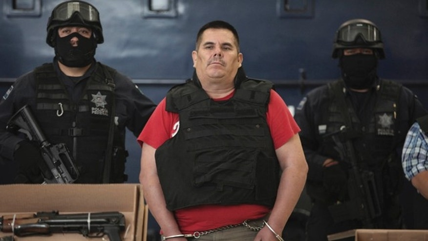 June 22: Jose de Jesus Mendez Vargas, alleged leader of Mexican La Familia drug cartel, looks on during his presentation to the press in Mexico City.
