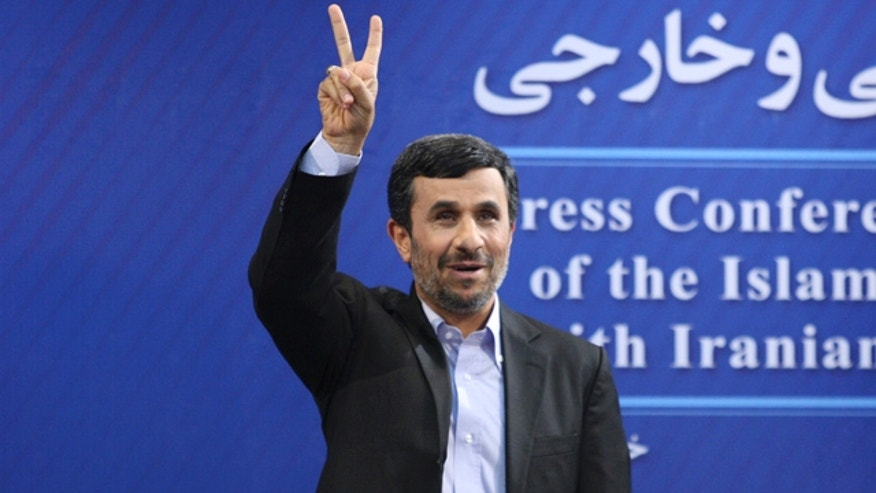 June 7: Iranian President Mahmoud Ahmadinejad flashes a victory sign as he arrives for his press conference in Tehran, Iran.