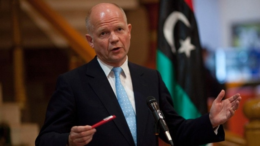 May 4: British Foreign Secretary William Hague gestures during a press conference in the rebel stronghold of Benghazi, Libya.