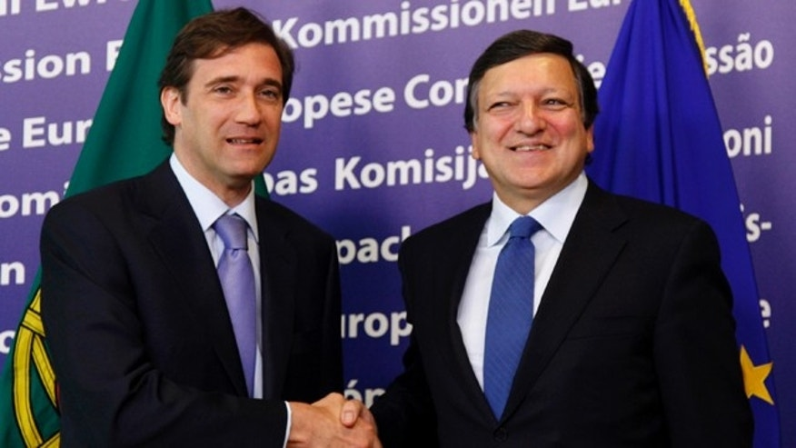 June 23: Portugal's Prime Minister Pedro Passos Coelho, left, shakes hands with European Commission President Jose Manuel Barroso at EU headquarters in Brussels.