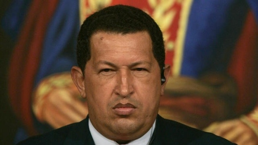 Venezuelan President Hugo Chavez gestures during a meeting with Chinese businessmen at Miraflores Palace in Caracas, Venezuela, Tuesday, Oct. 17, 2006. The picture in the background is the Venezuelan liberator Simon Bolivar. (AP Photo/Fernando Llano)