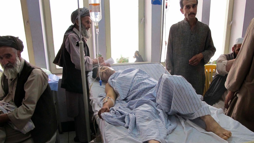 June 25: An injured Afghan man, a victim of a blast lies in a hospital bed in Kunduz city in the northern province of Kunduz, Afghanistan. A bicycle rigged with explosives ripped through a bazaar in the Khanabad district of Kunduz province on Friday, killing at least 10 people, including a police officer. At least 24 people were wounded in the attack, according to an Interior Ministry statement.