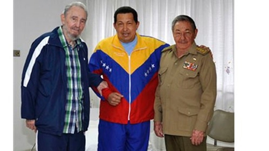 Jun 17: Hugo Chávez poses for a photo with Fidel and Raul Castro from his hospital room in Cuba.