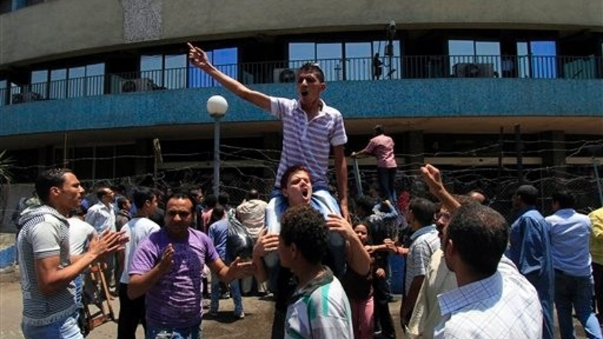 June 26: Egyptian members of families of people killed by security forces during the revolution hold a protest calling for the speedy trial of former President Hosni Mubarak and former interior minister Habib el-Adly in front of the National TV building in Cairo, Egypt.