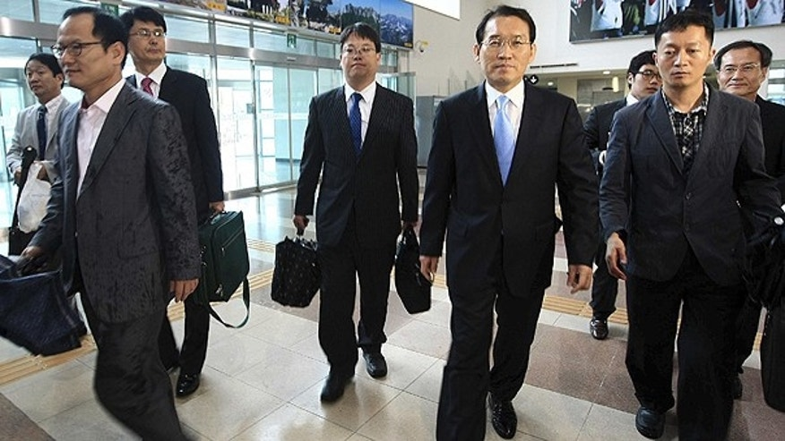 June 29: A group of South Korean government officials and businessmen leaves for North Korea's Diamond mountain at the inter-Korean immigration office in Goseong, South Korea.