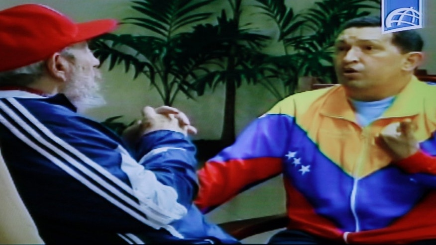 June 28: In this frame grab taken from video shown on Cuban state television, Cuba's Fidel Castro, left, speaks with Venezuela's President Hugo Chávez in an unknown location in Havana, Cuba. (AP Photo/Cuban state television)
