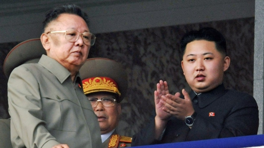 In this Oct. 10, 2010 file photo, Kim Jong Un, right, along with his father and North Korea leader Kim Jong Il, left, attend a massive military parade marking the 65th anniversary of the ruling Workers' Party in Pyongyang, North Korea.