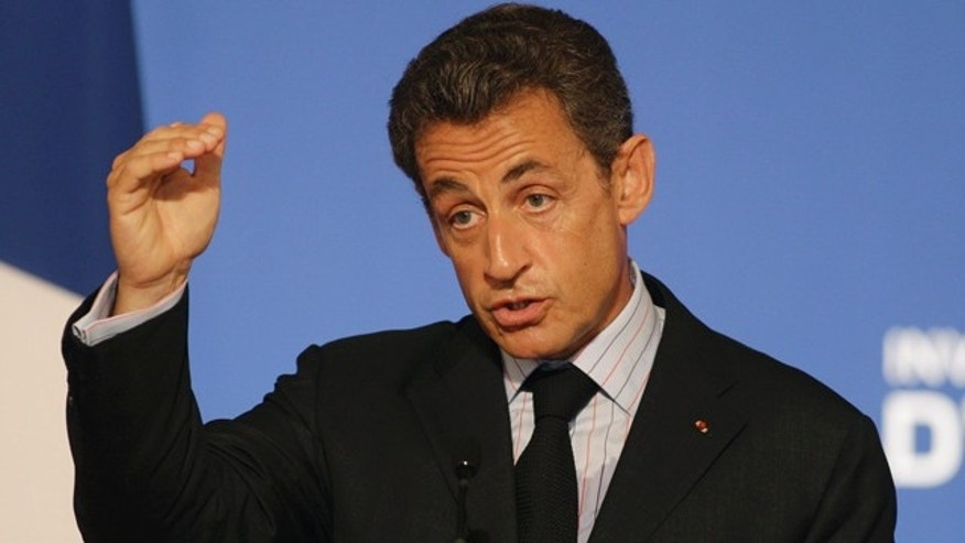 June 27: France's President Nicolas Sarkozy gestures as he speaks during a press conference at the Elysee Palace.