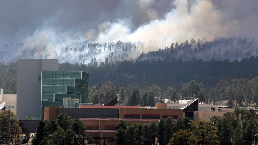 June 29: The Las Conchas fire burns near the Los Alamos Laboratory in Los Alamos. (AP Photo/Jae C. Hong)