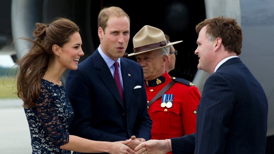 June 30: Prince William and Kate, the Duke and Duchess of Cambridge, are greeted by Canadian Foreign Affairs Minister John Baird upon their arrival in Ottawa, Canada, on their first official overseas trip.