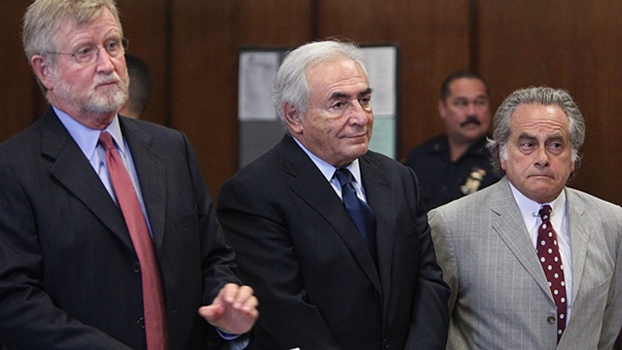 June 6: Former IMF leader Dominique Strauss-Kahn, center, appears at his arraignment on charges of sexually assaulting a Manhattan hotel maid, at Manhattan Criminal Court in New York.