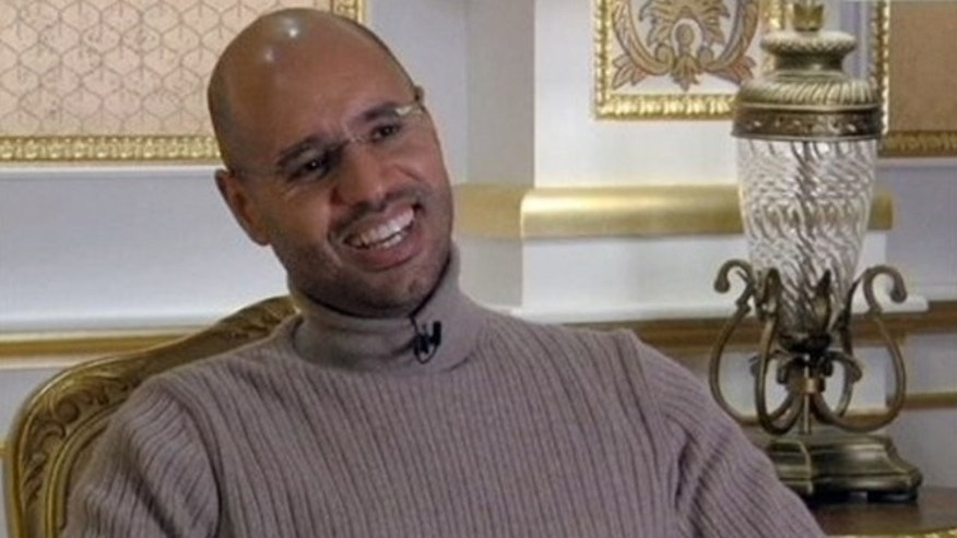 March 16: Seif al-Islam Qaddafi, son of Libyan Leader Muammar al-Qaddafi, smiles during a TV interview in Tripoli.