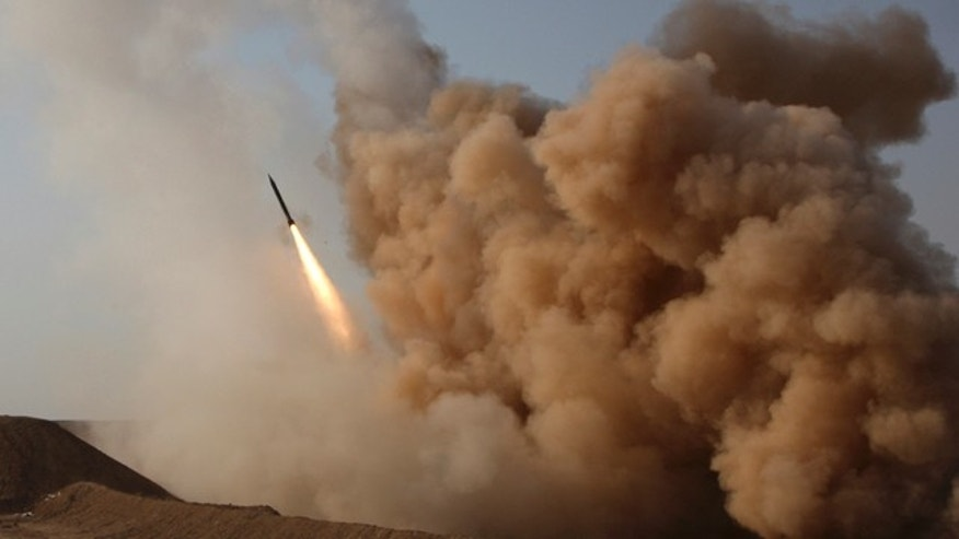 In this photo released by the semi-official Iranian Fars News Agency, and taken on Tuesday, June 28, 2011, a Zelzal missile is launched by the Iranian revolutionary Guards during their maneuvers outside the city of Qom, Iran.