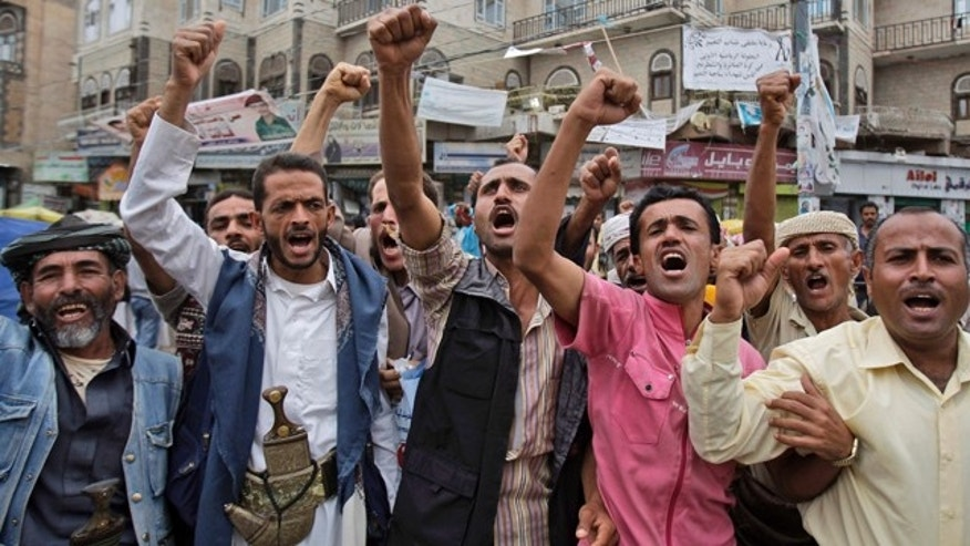July 5: Anti-government protestors shout slogans during a demonstration demanding the resignation of Yemeni President Ali Abdullah Saleh in Sanaa, Yemen.