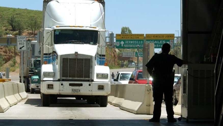 File Photo: Truck enters US from Mexico. (Photo by David McNew/Getty Images)