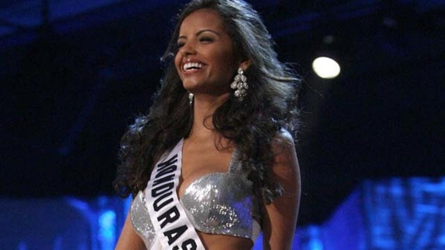 FILE -- In a  Aug. 16, 2009 file photo Miss Honduras, Belgica Suarez, walks the runway in the evening gown segment of the 2009 Miss Universe Preliminary Competition, in the Bahamas.  Honduran police say they have arrested Suarez on money laundering charges for failing to declare the equivalent of $47,000 when entering the country.   (AP Photo/Tim Aylen/file)