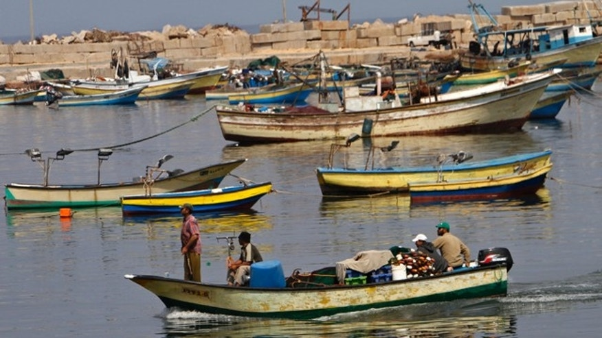 July 7: Palestinian fishermen arrive with their boat at the port of Gaza City.