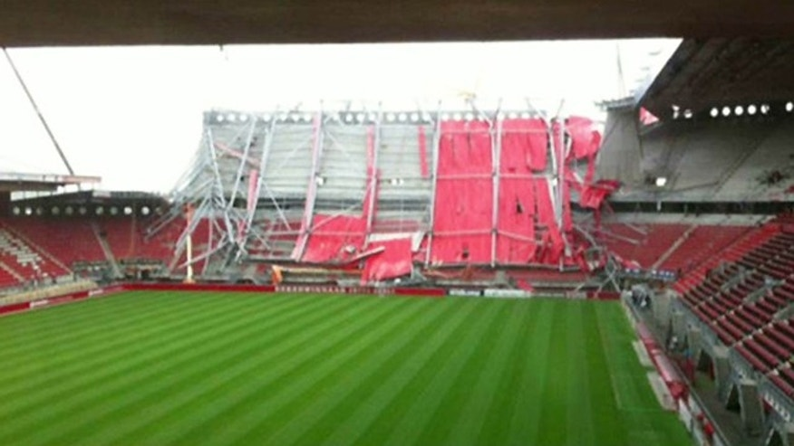 July 7: An unknown number of people are trapped after a Dutch football stadium collapsed.