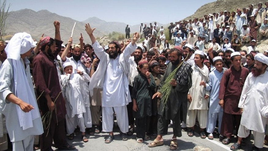 July 7: Afghans shout anti-U.S. slogans during a demonstration in Khost, Afghanistan.