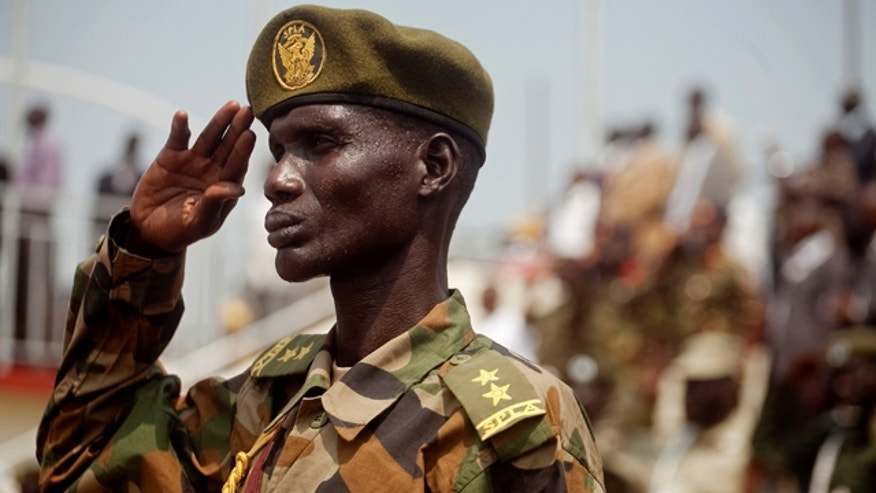 July 7: A Southern Sudanese soldiers stands at attention during the national anthem during an independence rehearsal procession in Juba, southern Sudan.