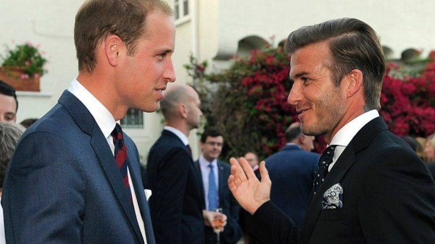 Prince William mingles with David Beckham during a private reception.