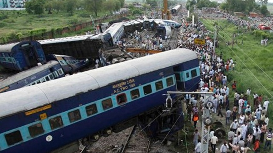 July 10: The wreckage of the Kalka Mail passenger train which derailed near the town of Fatehpur in Uttar Pradesh state, India.