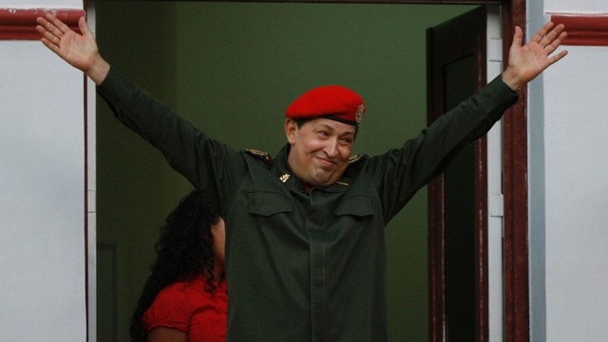 July 4: Venezuela's President Hugo Chávez greets supporters after returning to Venezuela from Cuba, where he underwent surgery to remove a cancerous tumor.