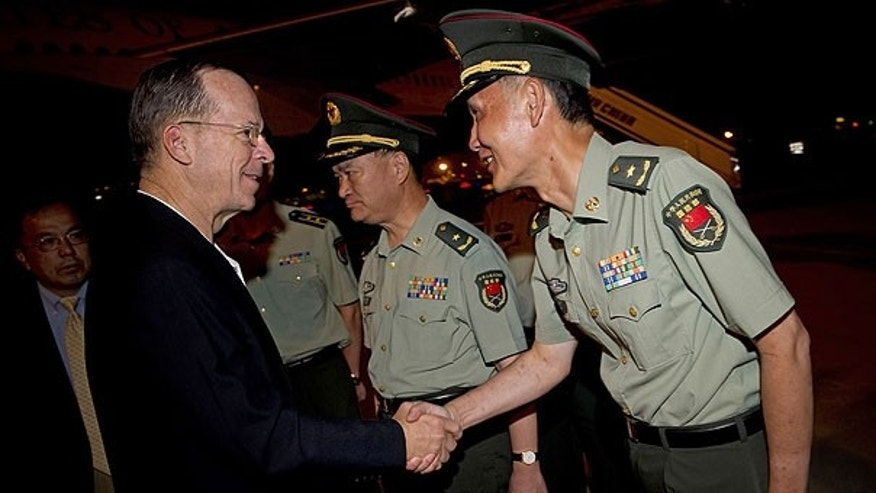 July 9: Chairman of the Joint Chiefs of Staff Adm. Mike Mullen greets Chinese officials upon his arrival to Beijing. The top U.S. military officer has arrived in Beijing on a visit aimed at improving chilly military relations.