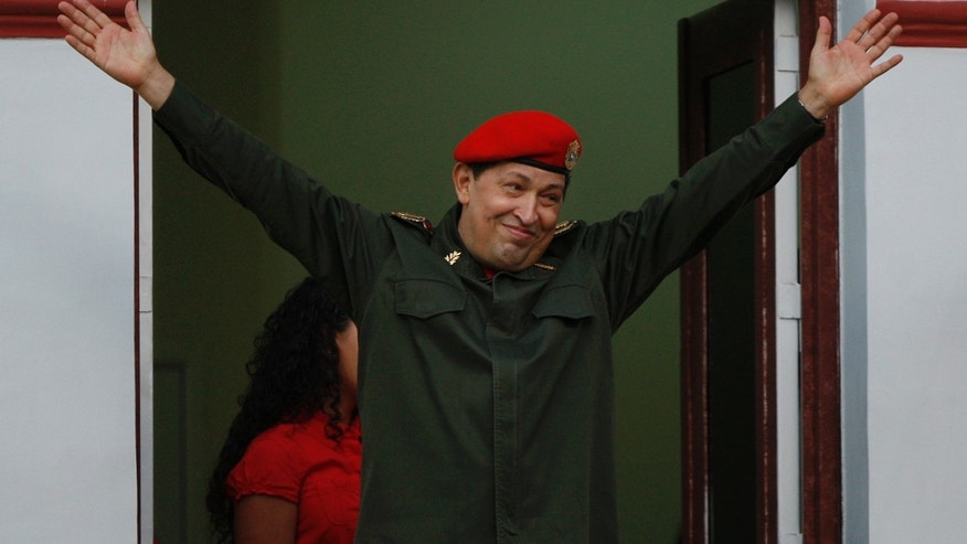July 4: President Hugo Chavez greets supporters from a balcony of the Miraflores presidential palace in Caracas, Venezuela.