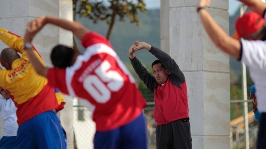 July 11: In this photo provided by Miraflores presidential press office, Venezuela's President Hugo Chavez, third right, exercises as part of his health recovery process at the Alejandro Petion military academy in Fuerte Tiuna, Caracas, Venezuela. AP Photo/Miraflores Presidential Office)