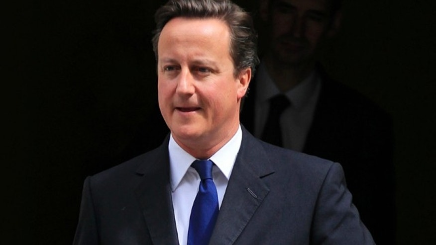 July 12: British Prime Minister David Cameron leaves 10 Downing Street.