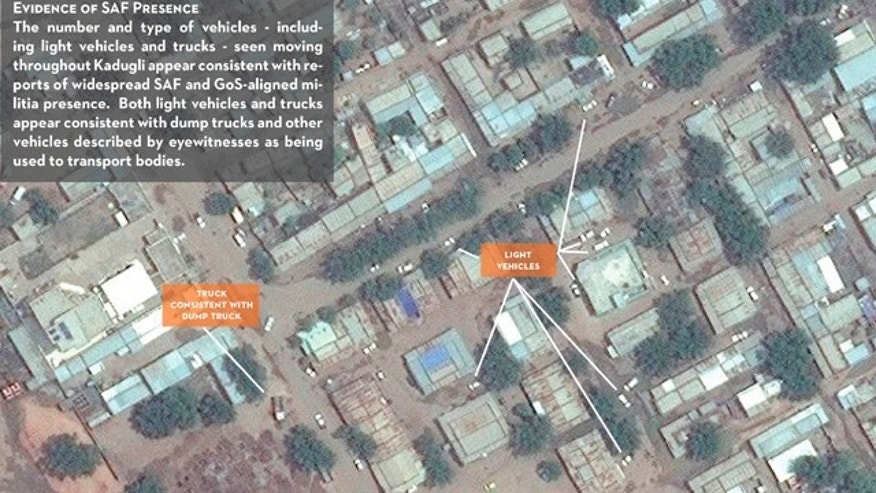 July 14: In this Digital Globe satellite image made available by the US monitoring group the Satellite Sentinel Project Thursday and analyzed by the Harvard Humanitarian Initiative, a dug-up site near Kadugli town in a sealed-off region of Sudan appears to be a mass grave, offering the first aerial photographs from a conflict zone that outside observers can't access.
