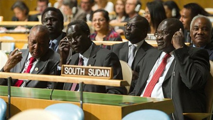 In this photo provided by the United Nations, members of the delegation of the Republic of South Sudan, led by Vice President Riek Machar Teny-Dhurgon, right, are seated in United Nations General Assembly, Thursday, July 14, 2011.