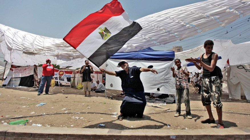 An Egyptian man dances with a national flag as he protests for a second day in Tahrir Square in Cairo, Egypt. What appeared an unstoppable groundswell for change across the Middle East earlier this year, has splintered into scattered and indecisive conflicts that have left thousands dead and Western policy makers juggling roles ranging from NATO airstrikes in Libya to worried bystanders in Syria and Yemen.