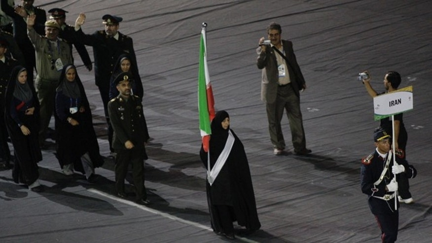 Members of Iran's military attend the opening ceremony of the fifth World Military Games in Rio de Janeiro, Brazil, Saturday July 16, 2011.  The Military Games will be held from July 15 to 24. (AP Photo/Silvia Izquierdo)