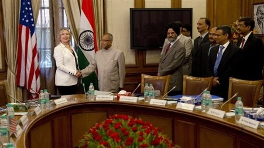 July 19: Indian Finance Minister Pranab Mukherjee shakes hands with U.S. Secretary of State Hillary Clinton prior to a meeting at the Cabinet Secretariat in New Delhi, India.