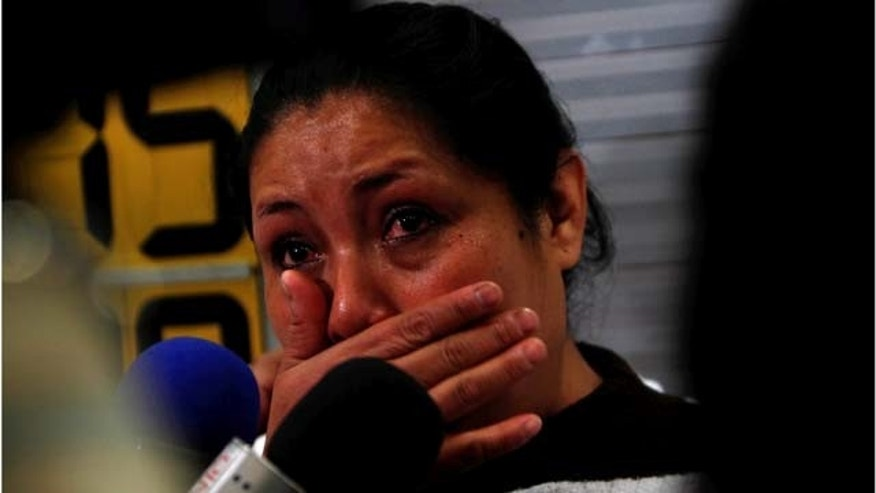 Margarita Almaraz, cries as she waits for the arrival of her two daughters at the airport in Mexico City, Monday, July 18, 2011. Almaraz and her husband were deported from the United States in 2009 after being caught without proper documents and could not get visas to appear to testify before U.S. courts for their daughters custody hearings but their lawyer convinced a court in Chester County, Pennsylvania, to accept the testimony via Skype.  It is the first time a U.S. court has allowed testimony in a custody case to be made over the Web via Skype according to their lawyers. (AP Photo/Marco Ugarte)