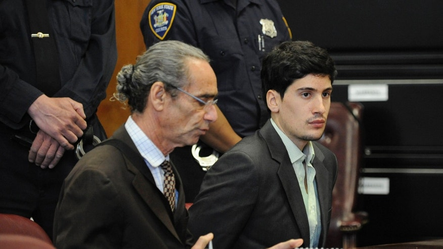 April 29: Renato Seabra, right, a Portuguese model, sits with an interpreter during a hearing at State Supreme court in New York. The U.S. Justice Department says many state courts are violating people's constitutional rights by not providing language interpreters for no charge for all their programs.