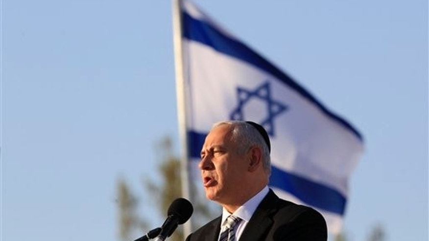 "July 21: Israel's Prime Minister Benjamin Netanyahu speaks during an official annual memorial ceremony for Theodor Herzl, the founder of modern Zionism, at Mount Herzl military cemetery in Jerusalem. With a September deadline looming, Israel's prime minister turned to the Arabic media Thursday for the first time since taking office two years ago in an attempt to lure the Palestinians back to peace talks, saying ""everything is on the table."""