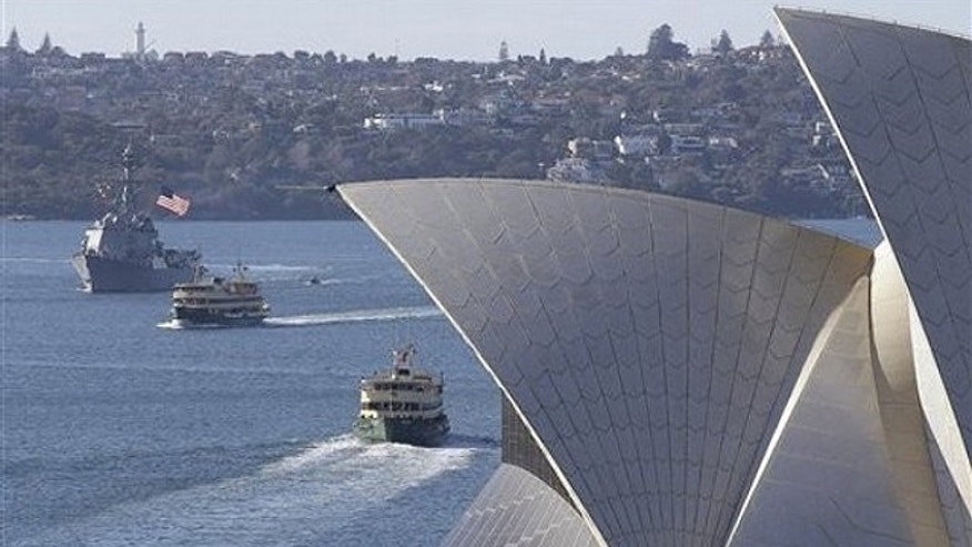 July 4: USS McCampbell sails past the Opera House in Sydney, Australia, on her way to berth alongside at Garden Island Naval base. The McCampbell and USS Fitzgerald arrived in Sydney on the U.S. Independence Day as part of a regular port call ahead of the Talisman Sabre war games to be held off the coast of Queensland later this month.