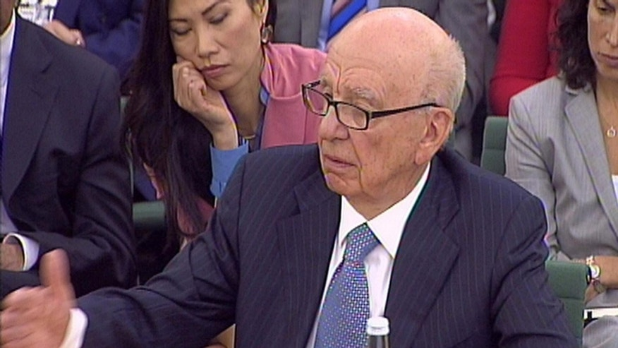 July 19: Rupert Murdoch gives evidence to the Culture, Media and Sport Select Committee on the News of the World phone-hacking scandal in this image taken from TV in Portcullis House in central London.
