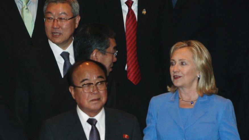 South Korean Foreign Minister Kim Sung-hwan, top left, walks by his North Korean counterpart Pak Ui Chun, bottom center, as U.S. Secretary of State Hillary Rodham Clinton talks with Japanese Foreign Minister Takeaki Matsumoto, center, prior to the start of ARF Retreat Session in Nusa Dua, Bali, Indonesia, Saturday, July 23, 2011.