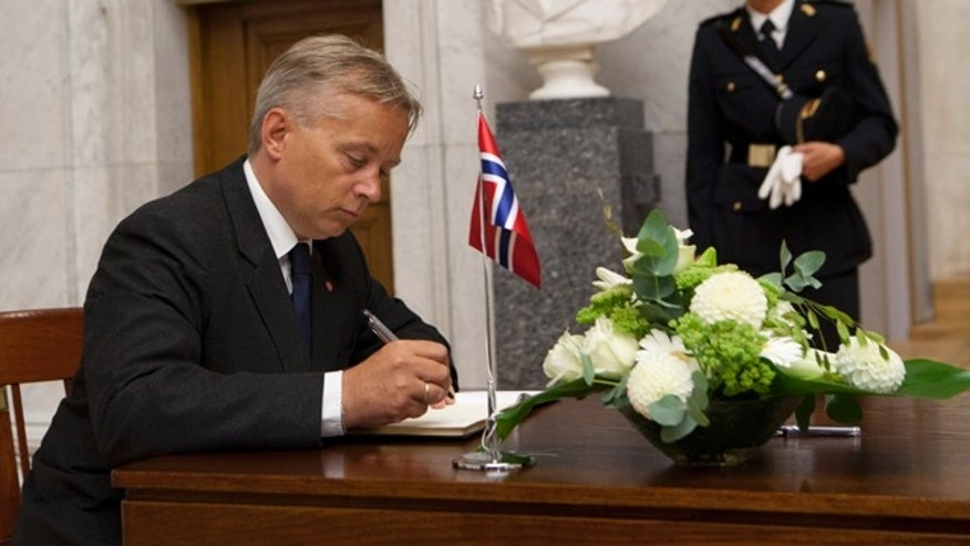 July 26: Norwegian minister of Justice, Knut Storberget, signs a protocol of condolence for the victims of last Friday's bomb attack and shooting massacre, in the Grand Hall of Oslo University.
